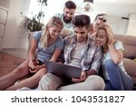 friends sitting together on the ... | Shutterstock . vector #1043531827