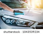 car detailing   the man holds... | Shutterstock . vector #1043539234