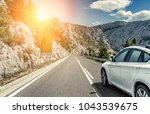 white car rushing along a high... | Shutterstock . vector #1043539675