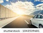white car rushing along a high... | Shutterstock . vector #1043539681