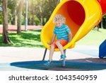 kids climbing and sliding on... | Shutterstock . vector #1043540959