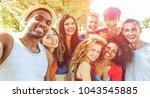 happy friends taking selfie at...   Shutterstock . vector #1043545885