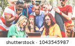 happy supporters from different ... | Shutterstock . vector #1043545987
