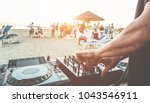 dj mixing at sunset beach party ... | Shutterstock . vector #1043546911