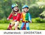children riding balance bike.... | Shutterstock . vector #1043547364