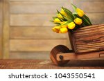 a bouquet of yellow tulips in a ... | Shutterstock . vector #1043550541
