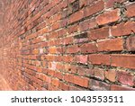red brick background with... | Shutterstock . vector #1043553511