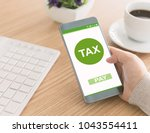 filing taxes online using... | Shutterstock . vector #1043554411