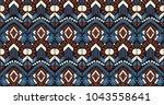 ikat geometric folklore... | Shutterstock .eps vector #1043558641