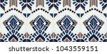 ikat geometric folklore... | Shutterstock .eps vector #1043559151