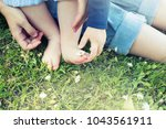 Mother And Baby Feet In Grass...