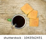 cup of tea and cookies on a...   Shutterstock . vector #1043562451