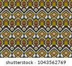 ikat geometric folklore... | Shutterstock .eps vector #1043562769