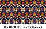 ikat geometric folklore... | Shutterstock .eps vector #1043562931