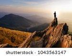 businessmen stand on high peaks ... | Shutterstock . vector #1043563147