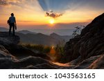 businessmen stand on high peaks ... | Shutterstock . vector #1043563165