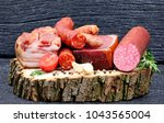 smoked sausage with spices and... | Shutterstock . vector #1043565004