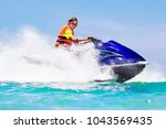 teenager on jet ski. teen age... | Shutterstock . vector #1043569435
