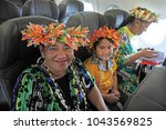 Small photo of AUCKLAND - DEC 05 2017: Cook Islanders flaying to Rarotonga from Auckland New Zealand. More than 60,000 Cook Islanders live in New Zealand and only 21,000 remain in the country.