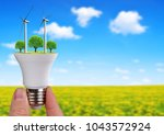 led bulb with wind turbines in... | Shutterstock . vector #1043572924