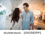 young couple shopping and... | Shutterstock . vector #1043583991