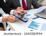 closeup of business partners... | Shutterstock . vector #1043583994