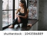 young woman in her pajamas... | Shutterstock . vector #1043586889