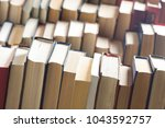 stack of books background. many ... | Shutterstock . vector #1043592757