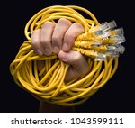a hand holding several yellow... | Shutterstock . vector #1043599111