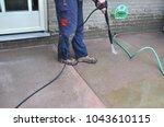 spring yard work   a man... | Shutterstock . vector #1043610115