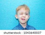 little cute boy is making faces.... | Shutterstock . vector #1043640037