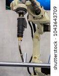 welding robot is movement in...   Shutterstock . vector #1043643709