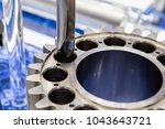 the cnc milling machine is...   Shutterstock . vector #1043643721