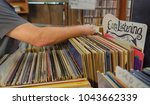 man going through used records...   Shutterstock . vector #1043662339