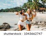 two cute beautiful girls in...   Shutterstock . vector #1043662747