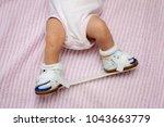 bottom half of a newborn baby... | Shutterstock . vector #1043663779