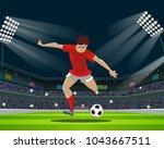 soccer player kicking ball in... | Shutterstock .eps vector #1043667511
