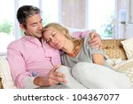 woman relaxing on husband laid... | Shutterstock . vector #104367077
