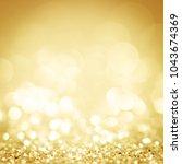 lights on gold background.... | Shutterstock . vector #1043674369