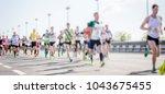 silhouette man running marathon  | Shutterstock . vector #1043675455