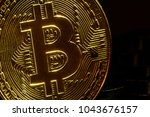 bitcoin coin stay on black... | Shutterstock . vector #1043676157