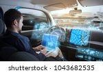 young man riding autonomous car. | Shutterstock . vector #1043682535