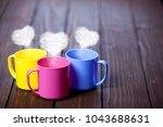 three cups of tea or coffee...   Shutterstock . vector #1043688631