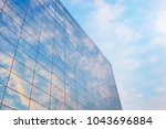 glass curtain wall in the sunset   Shutterstock . vector #1043696884