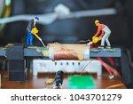 miniature people   worker team... | Shutterstock . vector #1043701279