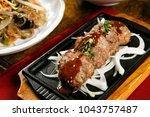 grilled short rib patties | Shutterstock . vector #1043757487