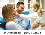 happy family is having fun in... | Shutterstock . vector #1043762575