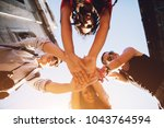 bottom view of four friends... | Shutterstock . vector #1043764594