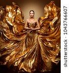 gold woman flying dress ... | Shutterstock . vector #1043766607