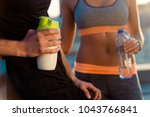 couple drinking protein... | Shutterstock . vector #1043766841